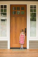 Little Girl in Front of Door