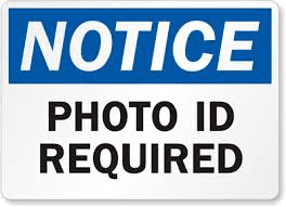Notice, photo ID required sign